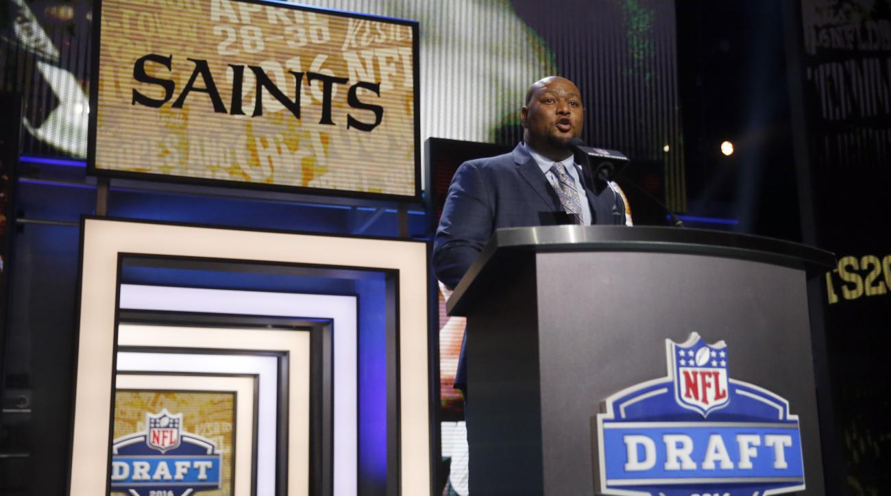 Former NFL player Deuce McAllister announces that the New Orleans Saints selects Ohio State's Michael Thomas as the 47th pick in the second round of the 2016 NFL football draft, Friday, April 29, 2016, in Chicago. (AP Photo/Charles Rex Arbogast)
