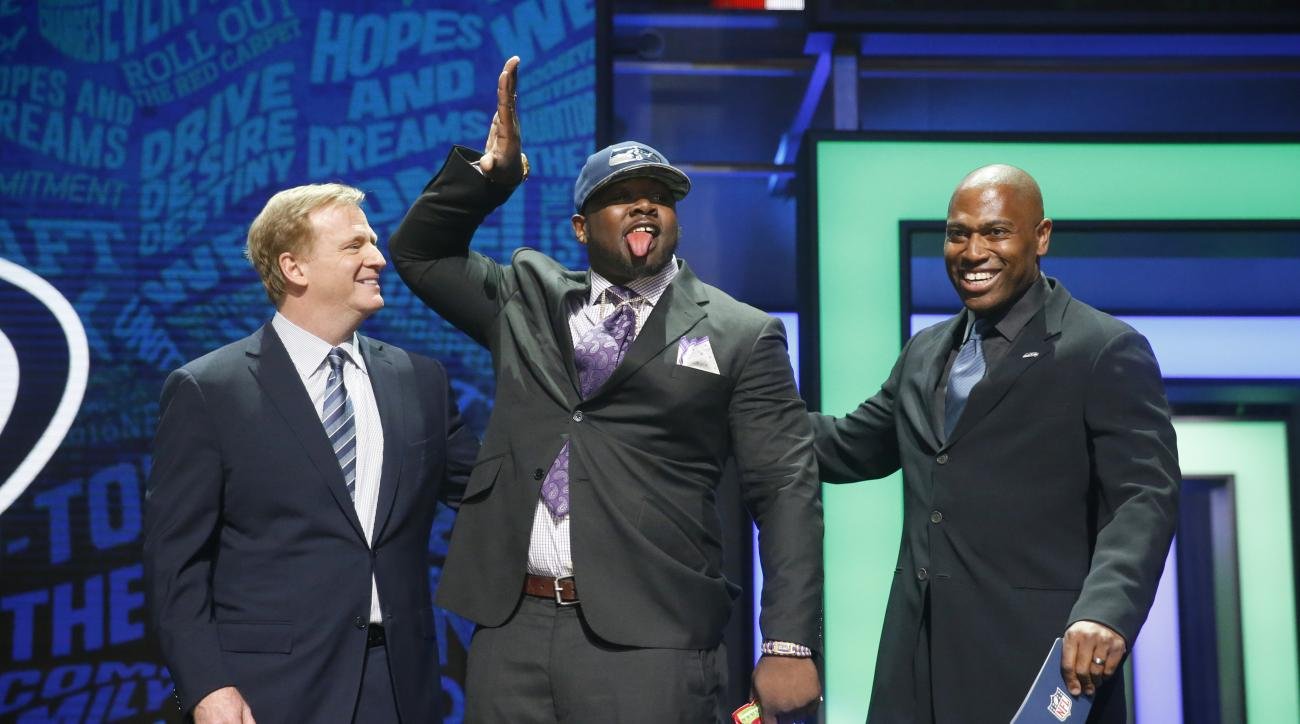 Alabamas Jarran Reed poses for photos with NFL Commissioner Roger Goodell, left, and former NFL player Shaun Alexander after being selected by the Seattle Seahawks as the 49th pick in the second round of the 2016 NFL football draft, Friday, April 29, 2016
