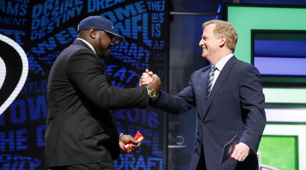 Alabamas Jarran Reed celebrates with NFL Commissioner Roger Goodell after being selected by the Seattle Seahawks as the 49th pick in the second round of the 2016 NFL football draft, Friday, April 29, 2016, in Chicago. (AP Photo/Charles Rex Arbogast)