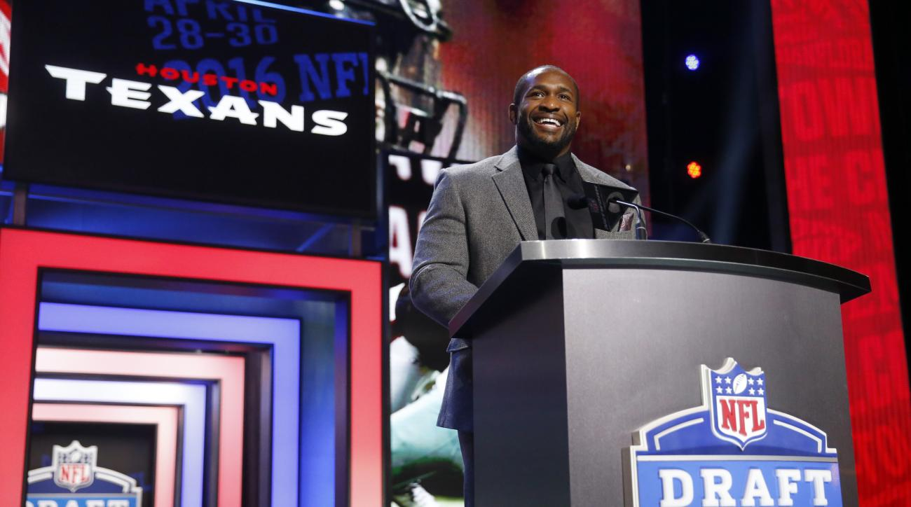 Former NFL player Amobi Okoye announces that the Houston Texans selects Notre Dames Nick Martin as the 50th pick in the second round of the 2016 NFL football draft, Friday, April 29, 2016, in Chicago. (AP Photo/Charles Rex Arbogast)