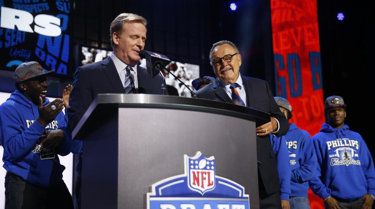 NFL Commissioner Roger Goodell introduces former NFL player Dick Butkus before Butkus announces that the Chicago Bears selects Kansas States Cody Whitehair as the NUMBER pick in the second round of the 2016 NFL football draft, Friday, April 29, 2016, in C