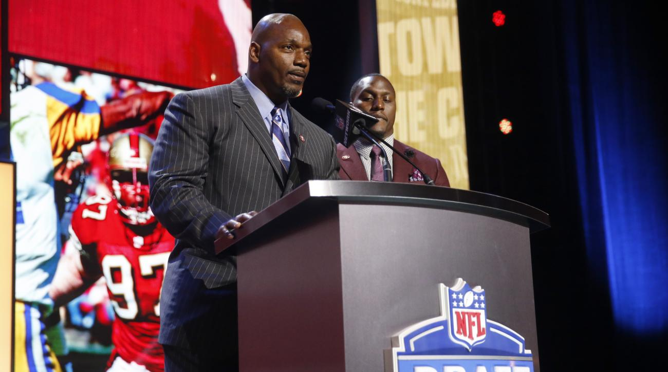 Former NFL players Bryant Young and Former Walter Payton Men of the Year Takeo Spikes announce that the San Francisco 49ers selects Mississippi States Will Redmond as the 68th pick in the third round of the 2016 NFL football draft, Friday, April 29, 2016,