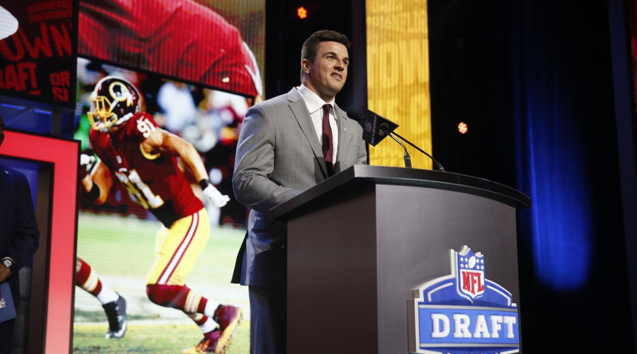 Former Walter Payton Men of the Year Ryan Kerrigan announces that the Washington Redskins selects Virginia Techs Kendall Fuller as the 84th pick in the third round of the 2016 NFL football draft, Friday, April 29, 2016, in Chicago. (AP Photo/Charles Rex A