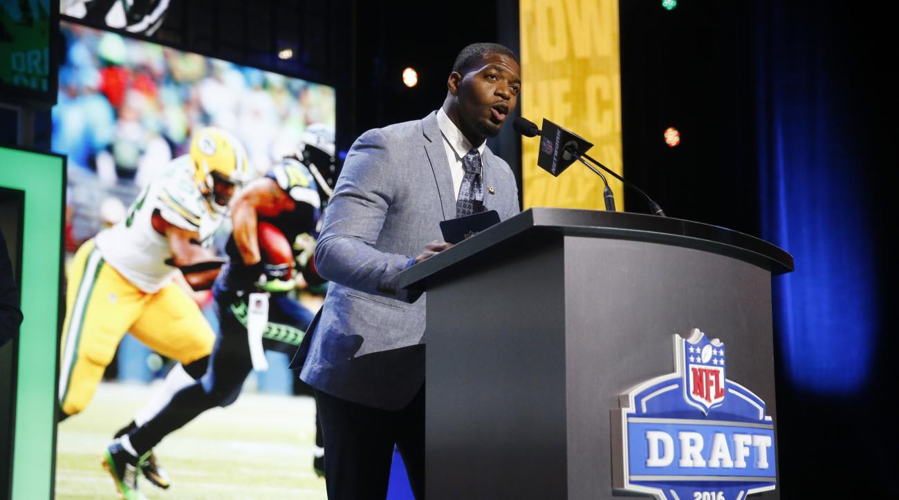 Former Walter Payton Men of the Year Sam Barrington announces that the Green Bay Packers selects Utah States Kyler Fackrell as the 88th pick in the third round of the 2016 NFL football draft, Friday, April 29, 2016, in Chicago. (AP Photo/Charles Rex Arbog