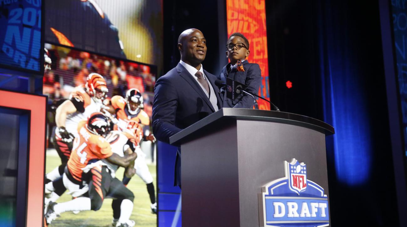Former Walter Payton Men of the Year DeMarcus Ware announces that the Denver Broncos selects Boston College's Justin Simmons as the 98th pick in the third round of the 2016 NFL football draft, Friday, April 29, 2016, in Chicago. (AP Photo/Charles Rex Arbo
