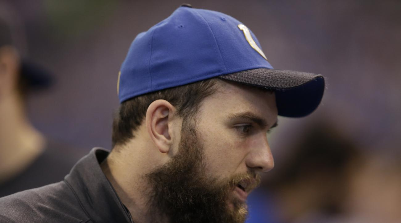 Indianapolis Colts quarterback Andrew Luck (12) on the bench during the first half of an NFL football game against the Tennessee Titans in Indianapolis, Sunday, Jan. 3, 2016. (AP Photo/Darron Cummings)