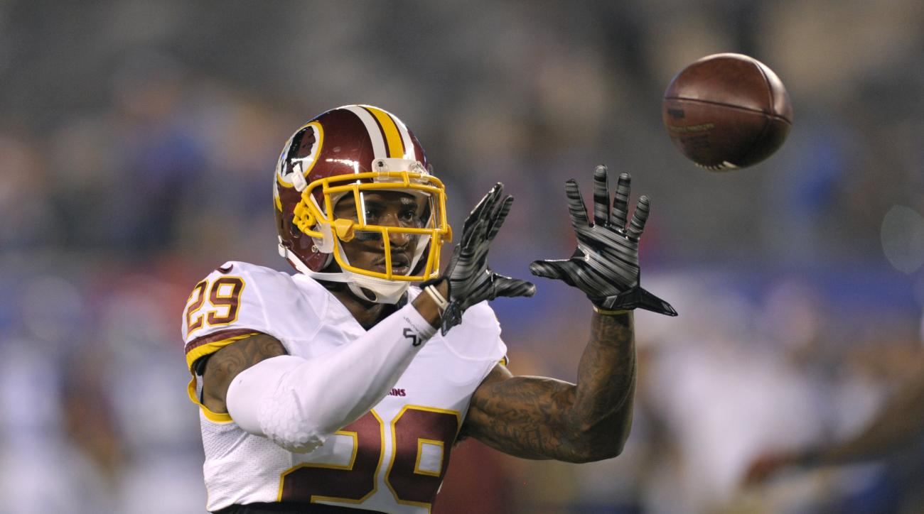 In this photo taken Sept. 24, 2015, Washington Redskins cornerback Chris Culliver catches a pass before an NFL football game against the New York Giants in East Rutherford, N.J. The Redskins have released Culliver, who is still recovering from a knee inju