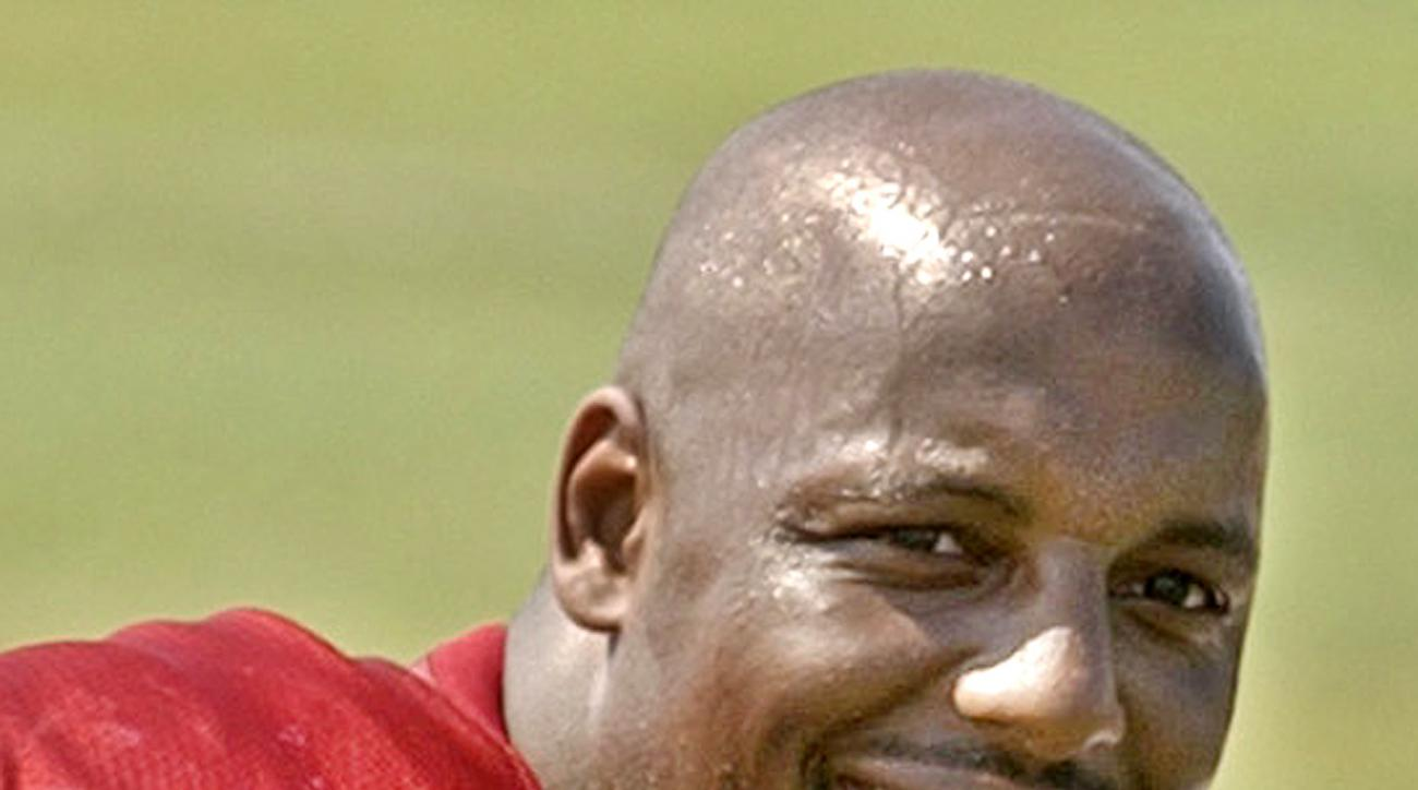 San Francisco 49ers right tackle Dana Stubblefield poses on the practice field at the 49ers training camp in Stockton, Calif., Monday, July 29, 2002.  Stubblefield, released by San Francisco last month in a salary cap move, moved across the Bay on Wednesd