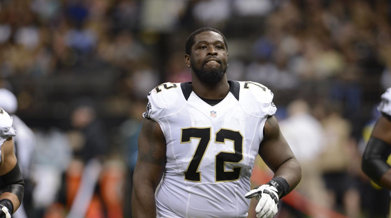 New Orleans Saints tackle Terron Armstead (72) walks on the field in the first half of a preseason NFL football game against the New England Patriots in New Orleans, Saturday, Aug. 22, 2015. (AP Photo/Bill Feig)