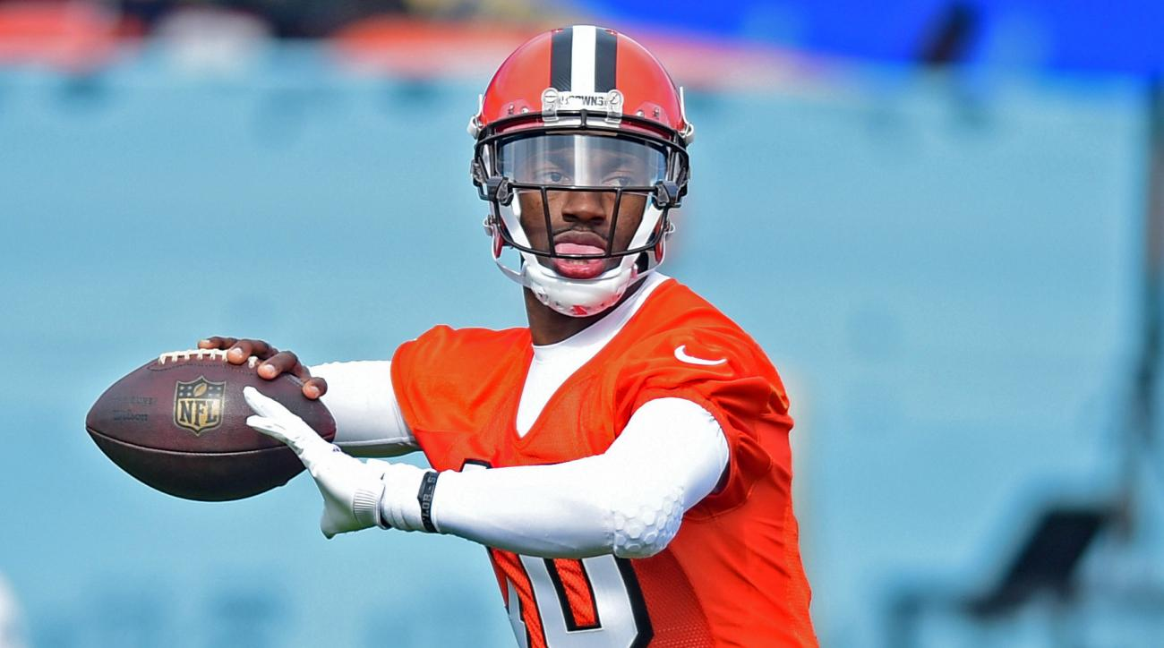 FILE - In this April 19, 2016, file photo, Cleveland Browns' Robert Griffin III throws a pass during practice at the NFL football team's veteran minicamp in Berea, Ohio. The Browns quarterback posed as a mannequin on Tuesday, May 3, 2016, before surprisin