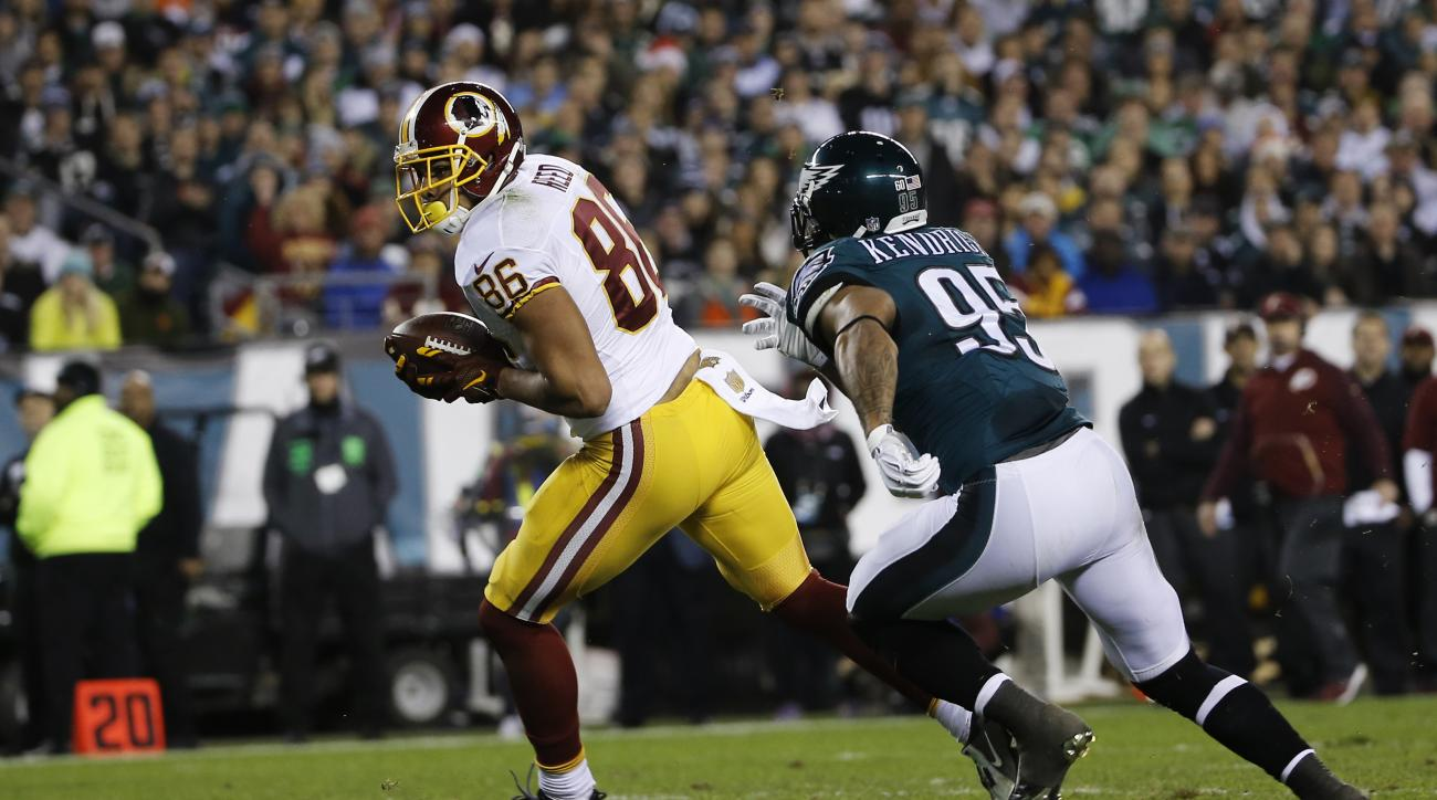In this photo taken Dec, 26, 2015, Washington Redskins' Jordan Reed (86) runs for a touchdown after a catch against Philadelphia Eagles' Mychal Kendricks (95) in the first half of an NFL football game in Philadelphia. The Washington Redskins have signed t