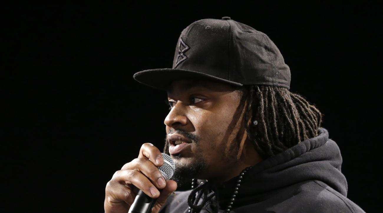 Marshawn Lynch, a former NFL football running back with the Seattle Seahawks, speaks Thursday, May 5, 2016, at a job fair in Seattle sponsored by the 100,000 Opportunities Initiative, an organization backed by Starbucks and other companies that seeks to i