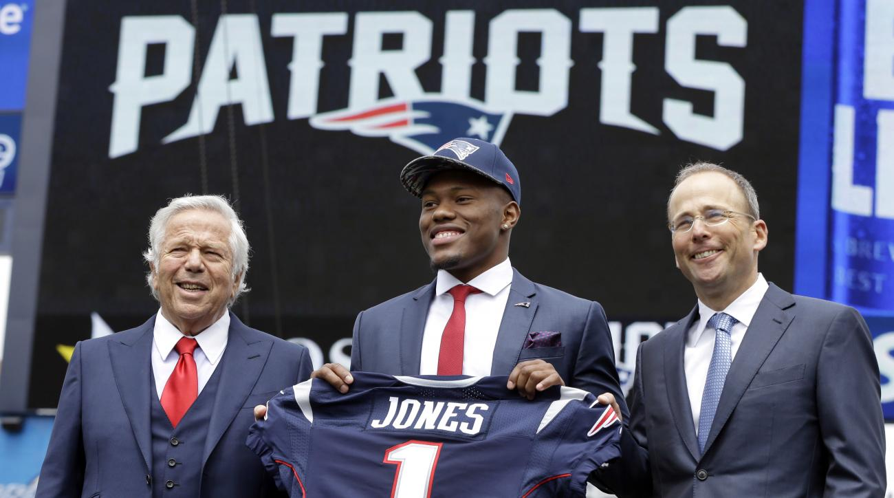 New England Patriots NFL football top draft pick, Cyrus Jones, is introduced by team owner Robert Kraft, left, and team president Jonathan Kraft, right, at Gillette Stadium, Friday, May 6, 2016, in Foxborough, Mass. (AP Photo/Elise Amendola)