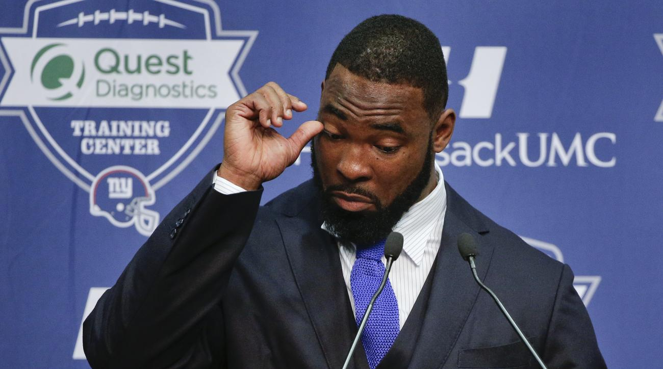 New York Giants defensive end Justin Tuck speaks during a news conference in which he announced his retirement, Friday, May 6, 2016, in, East Rutherford, N.J. (AP Photo/Julie Jacobson)
