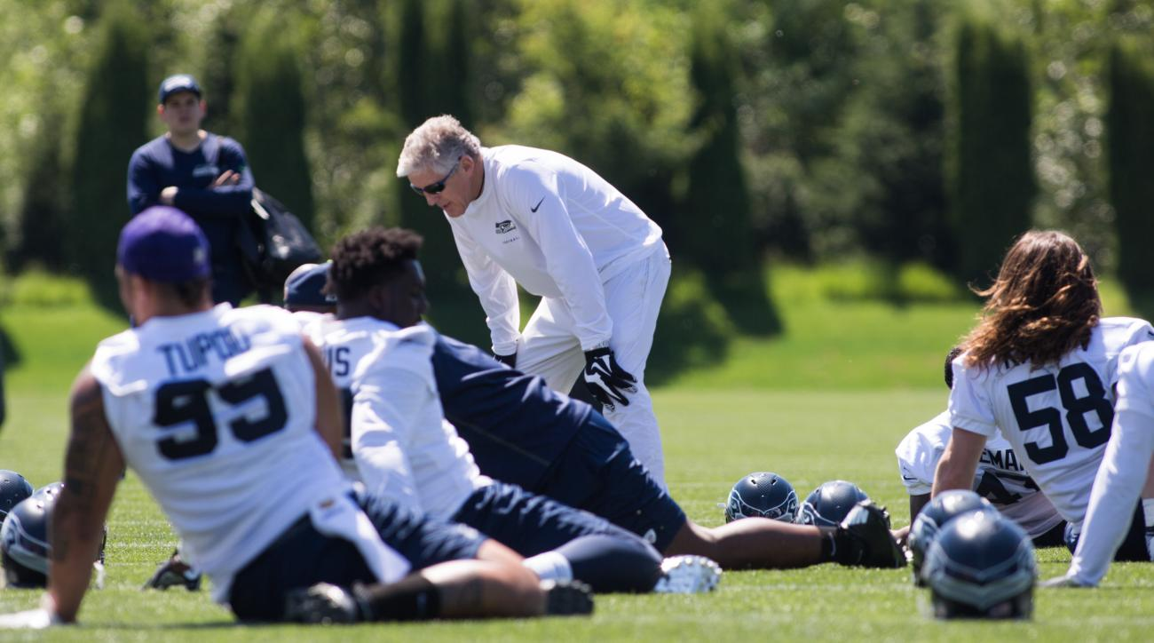 Head coach Pete Carroll talks to players as they stretch during the first day of the Seattle Seahawks NFL football rookie minicamp on Friday, May 6, 2016 at Virginia Mason Athletic Center in Renton, Wash. (Grant Hindsley/seattlepi.com via AP)