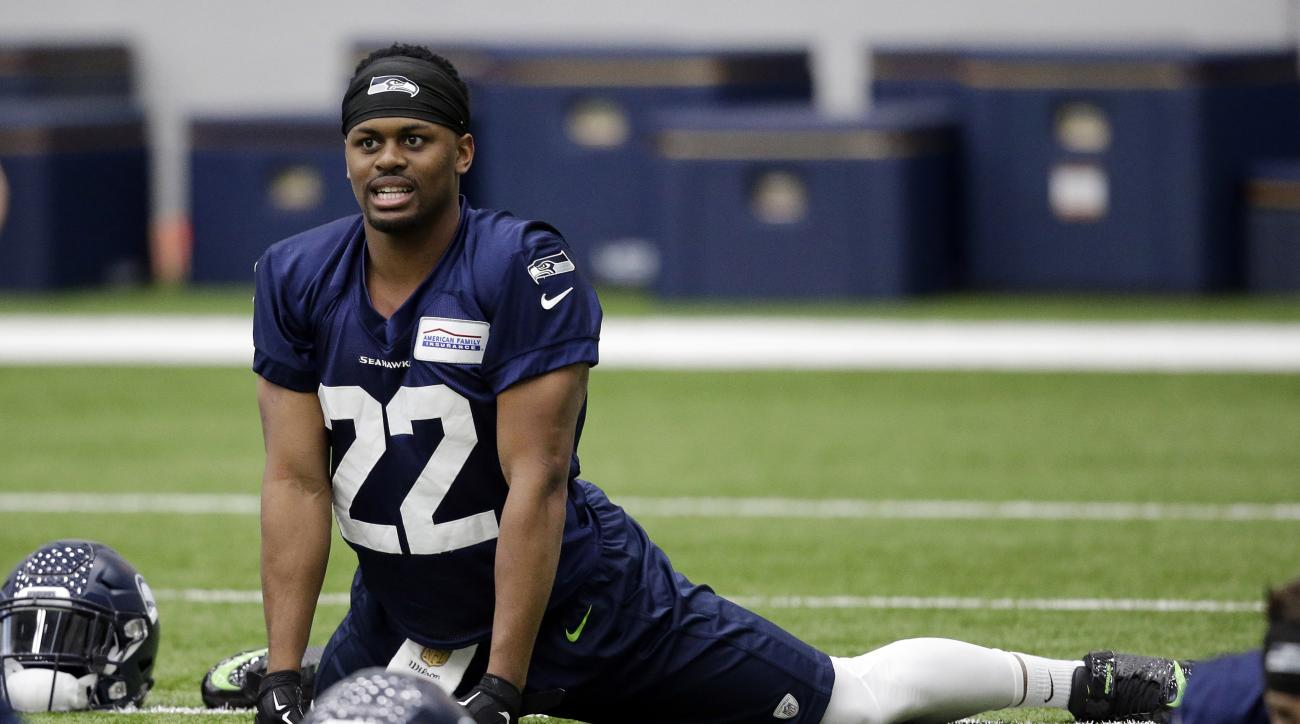 Seattle Seahawks' C.J. Prosise stretches during an NFL football rookie minicamp workout Sunday, May 8, 2016, in Renton, Wash. (AP Photo/Elaine Thompson)