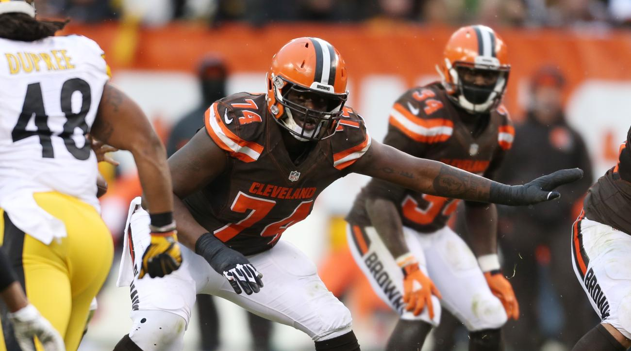 FILE - In this Jan. 3, 2016, file photo, Cleveland Browns offensive tackle Cameron Erving (74) competes against the Pittsburgh Steelers during the second half of an NFL football game in Cleveland. A teenager in Ohio got a treat on prom night: a surprise d