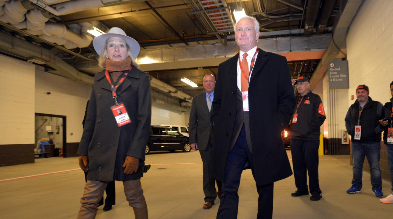 FILE - In this Nov. 30, 2015, file photo, Cleveland Browns owner Jimmy Haslam, right, and his wife Dee Haslam walk to the playing field before an NFL football game against the Baltimore Ravens in Cleveland. The Browns owners  are paying more than $2 milli