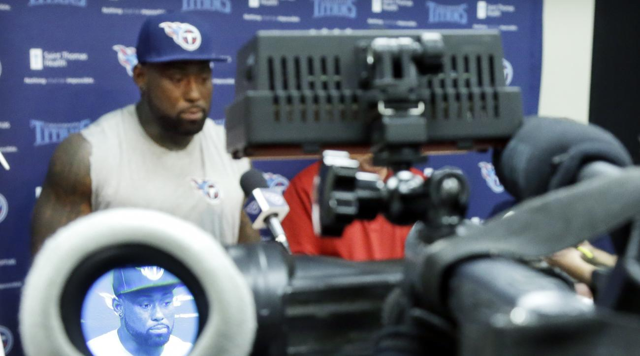The image of Tennessee Titans tight end Delanie Walker is seen in a television camera viewfinder as he answers questions during a news conference Wednesday, May 11, 2016, in Nashville, Tenn. The Titans have worked hard to surround quarterback Marcus Mario