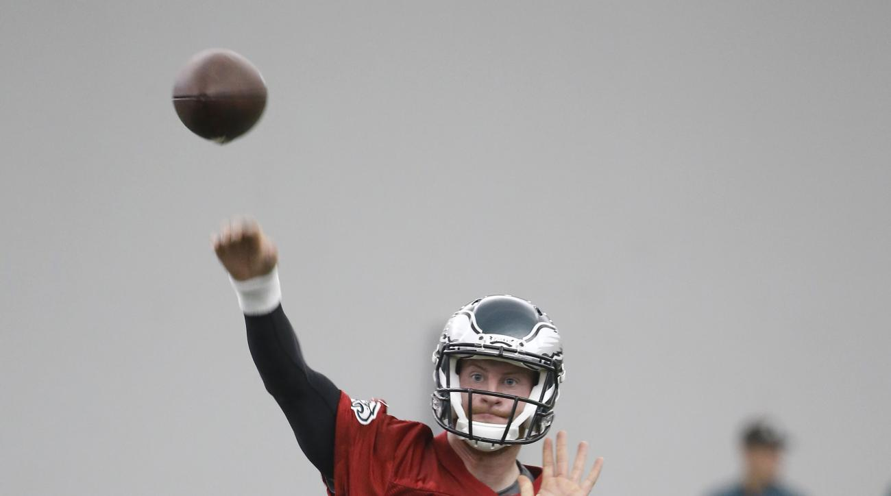 Quarterback Carson Wentz throws a pass during the Philadelphia Eagles' rookie minicamp at the team's NFL football training facility, Friday, May 13, 2016, in Philadelphia. (AP Photo/Matt Rourke)