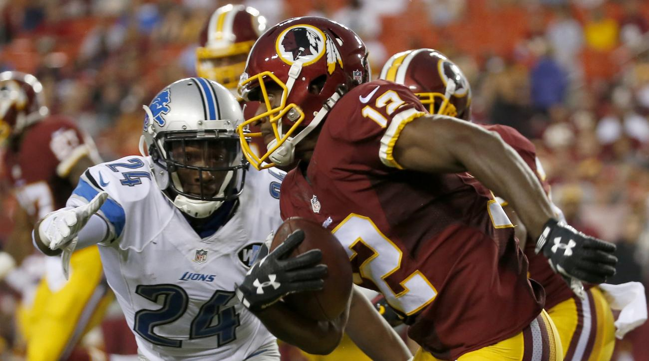 In this photo taken Aug. 20, 2015, Washington Redskins wide receiver Andre Roberts (12) runs past Detroit Lions cornerback Nevin Lawson (24) during the first half of an NFL preseason football game in Landover, Md. The Washington Redskins have released wid