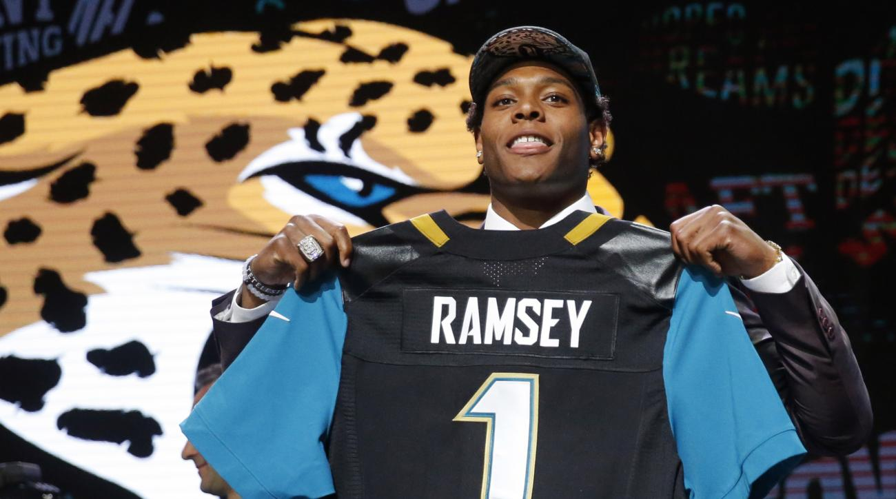 FILE - In this April 28, 2016, file photo, Florida States Jalen Ramsey poses for photos after being selected by Jacksonville Jaguars as fifth pick overall in the first round of the NFL football draft in Chicago. Ramsey could be sidelined for offseason wor