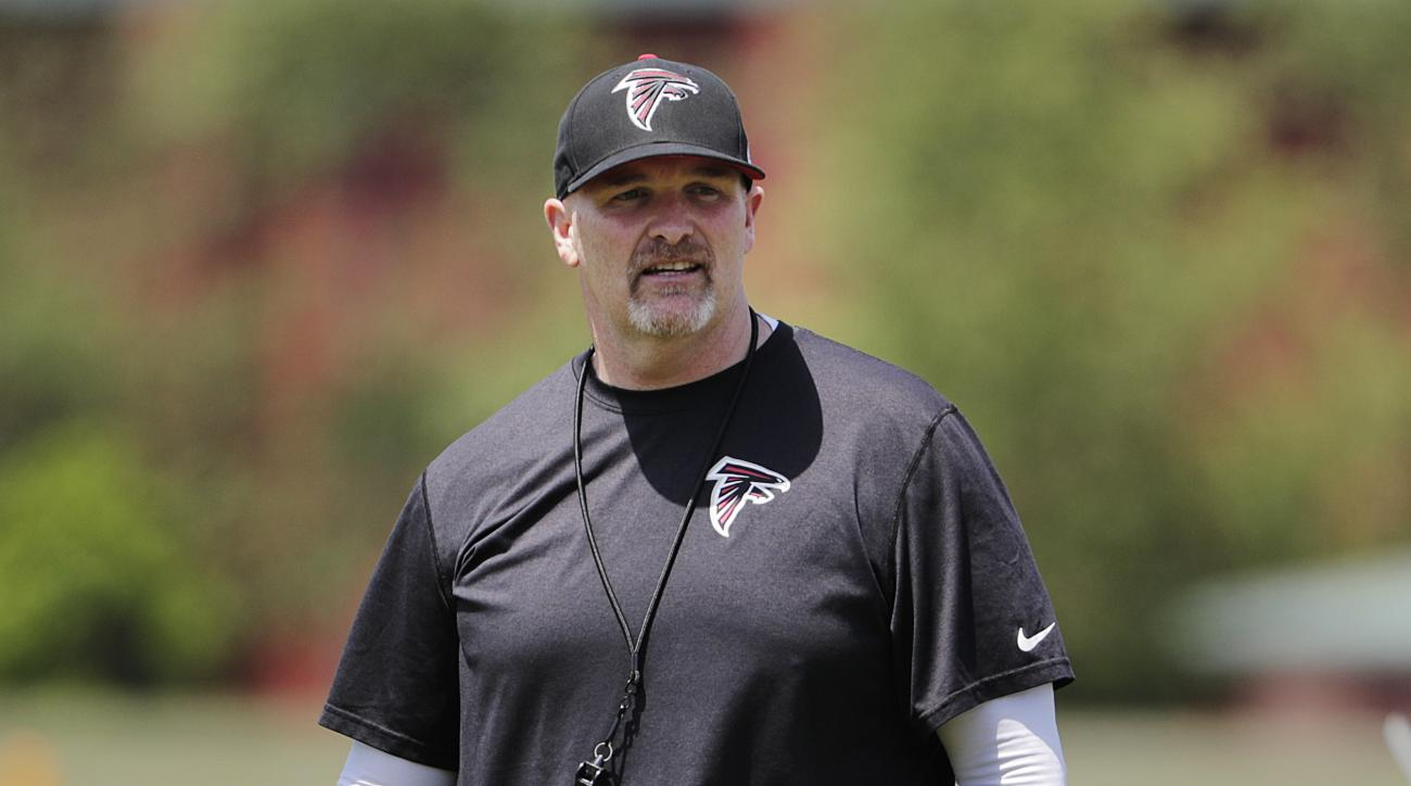 Atlanta Falcons head coach Dan Quinn walks through an NFL football practice Monday, May 23, 2016, in Flowery Branch, Ga. (AP Photo/David Goldman)