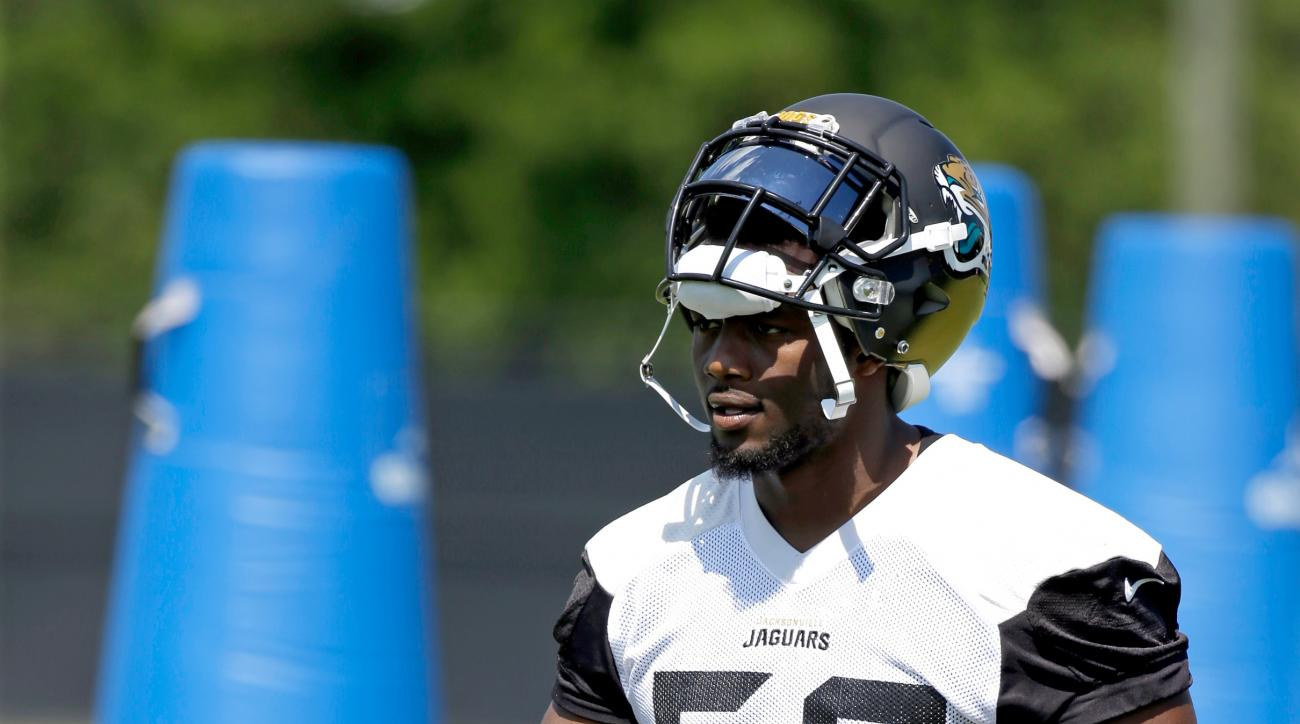Jacksonville Jaguars defensive end Dante Fowler walks across the field after a drill during NFL football practice, Monday, May 23, 2016, in Jacksonville, Fla. (AP Photo/John Raoux)