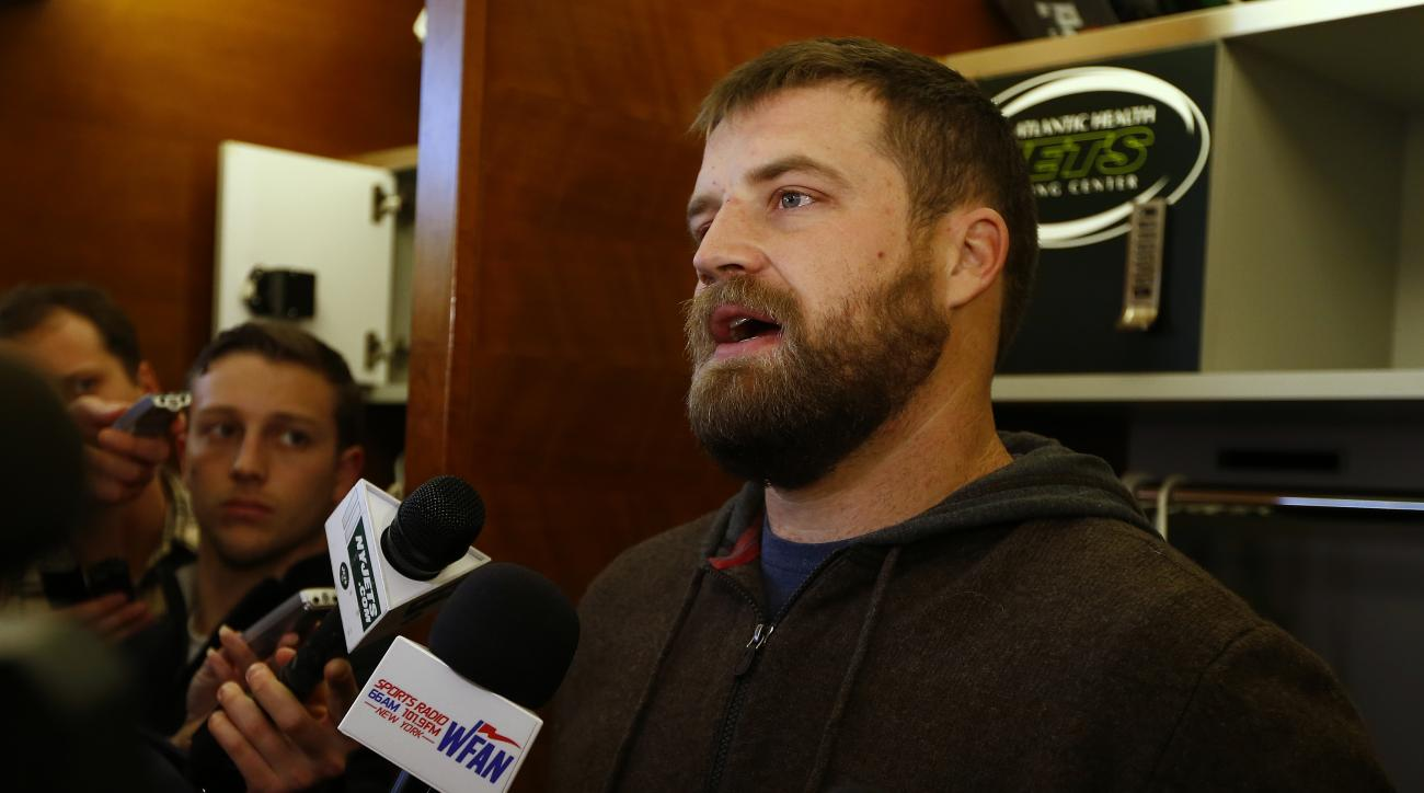 New York Jets quarterback Ryan Fitzpatrick talks to the media as the team clears out their lockers at the team's NFL football training facility, Monday, Jan.4, 2016, in Florham Park, N.J. (AP Photo/Rich Schultz)
