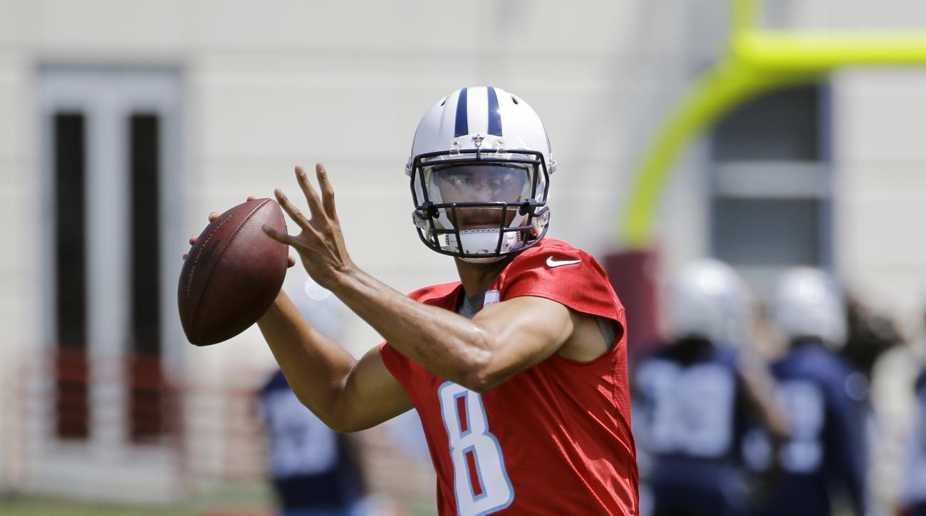 Tennessee Titans quarterback Marcus Mariota passes during NFL football practice Tuesday, May 24, 2016, in Nashville, Tenn. (AP Photo/Mark Humphrey)