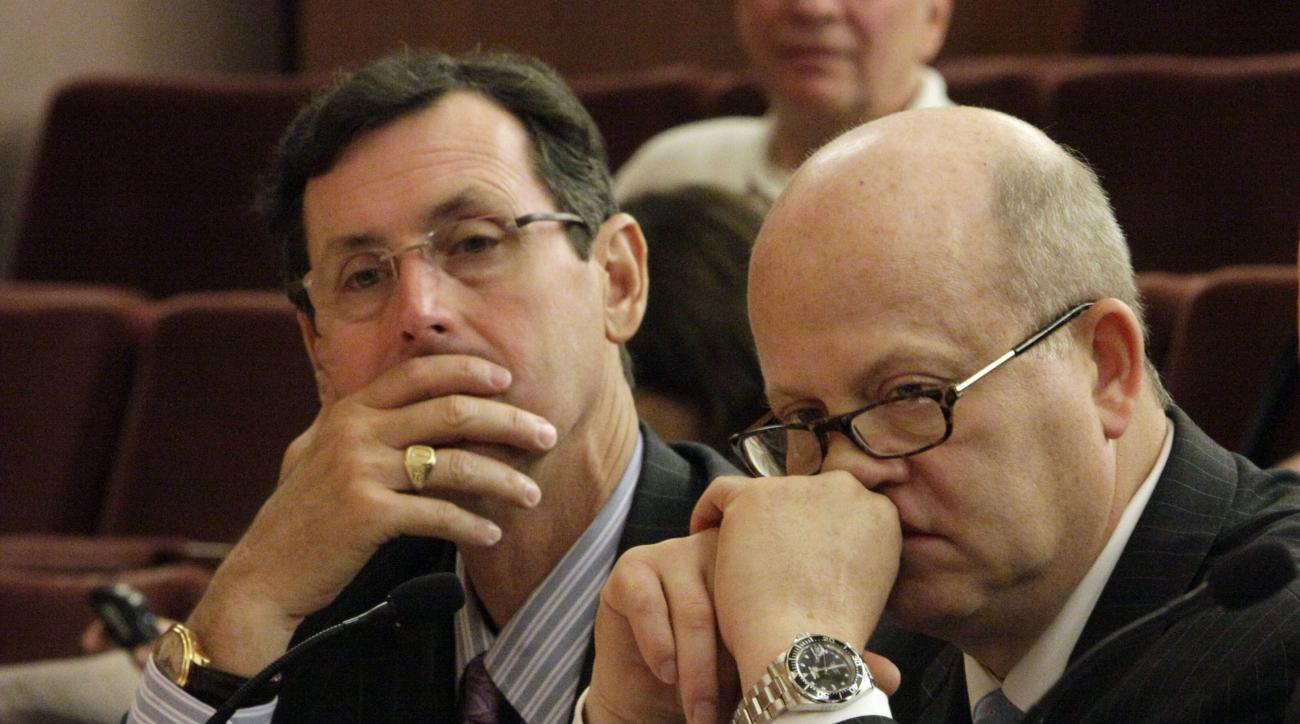 Dr. Hunt Batjer, left, and Dr. Richard Ellenbogen, co-chairs of the NFL Head, Neck, and Spine Medical Committee, listen to testimony before the House Judiciary Committee forum on key issues related to the indication and and prevention of head injuries in