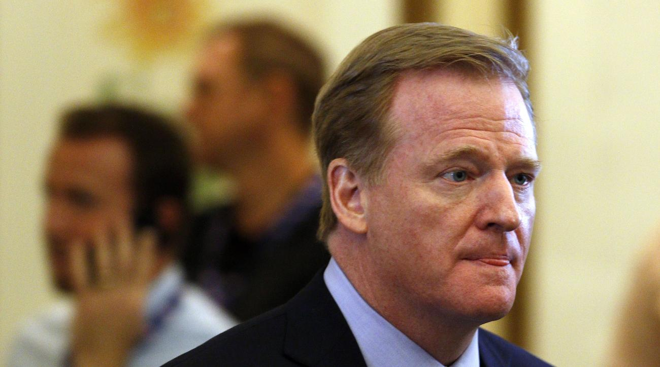 FILE - In this Tuesday, May 24, 2016, file phot, NFL commissioner Roger Goodell makes his way into the NFL owner's meeting in Charlotte N.C.  Goodell reaffirmed the league's commitment to concussion research in a letter Thursday, May 26, 2016,  to the 32