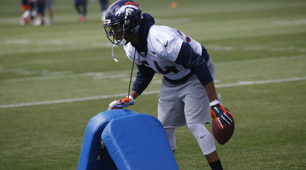 Denver Broncos inside linebacker Brandon Marshall sets up pads for a drill during an NFL football practice, Tuesday, May 31, 2016, at the team's headquarters in Englewood, Colo. (AP Photo/David Zalubowski)