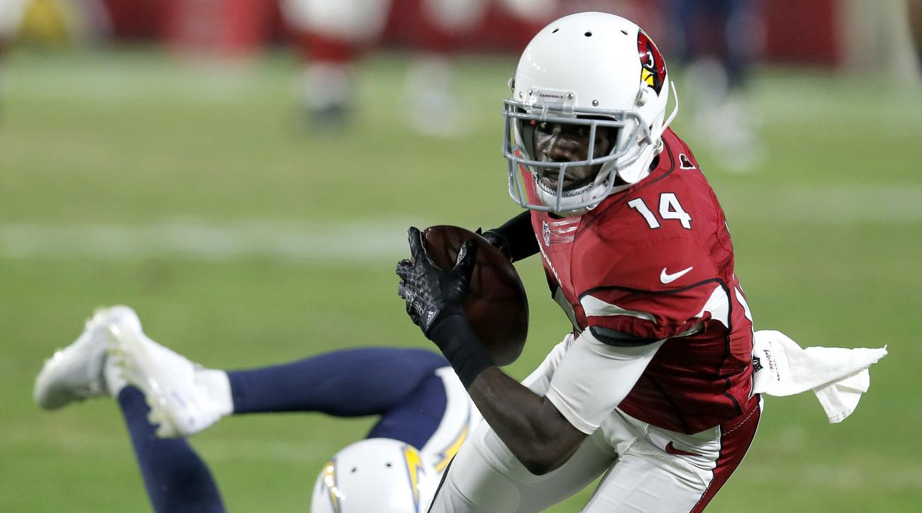 FILE - In this Saturday, Aug. 22, 2015 file photo, Arizona Cardinals wide receiver J.J. Nelson (14) pulls in a pass as San Diego Chargers cornerback Richard Crawford (35) defends during the first half of an NFL preseason football game in Glendale, Ariz. N