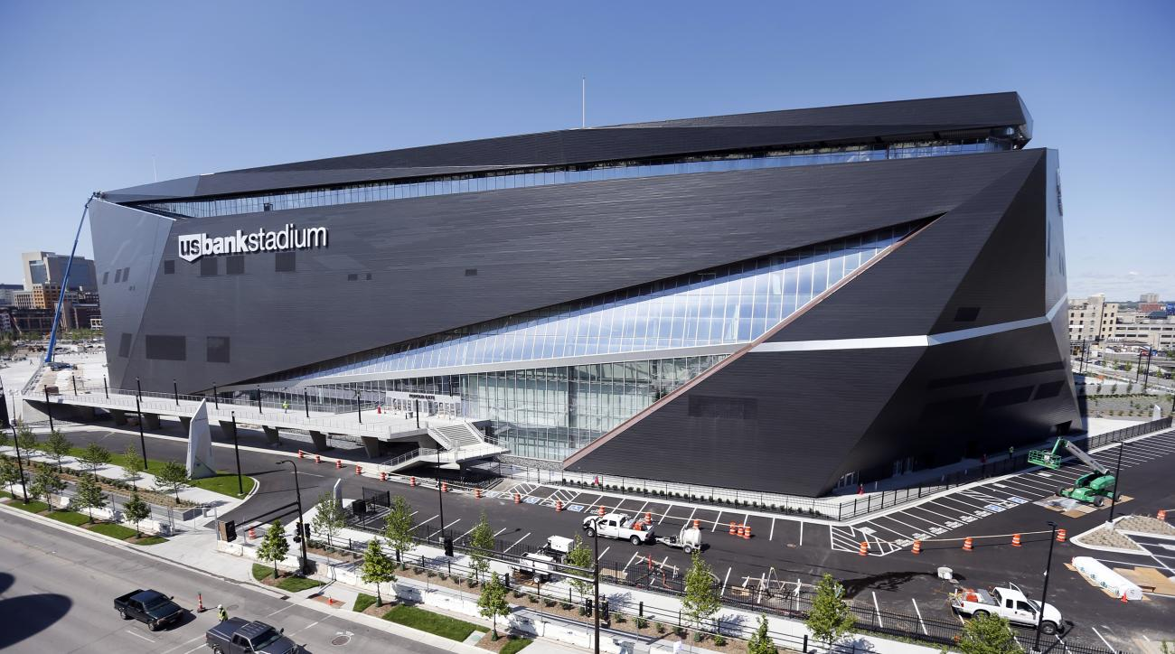 FILE - In this Thursday, June 2, 2016 file photo, finishing touches are made on U.S. Bank Stadium, the new home of the Minnesota Vikings NFL football team  in Minneapolis. The Vikings will open their 2016 season in the $1.2 billion stadium. The Minnesota