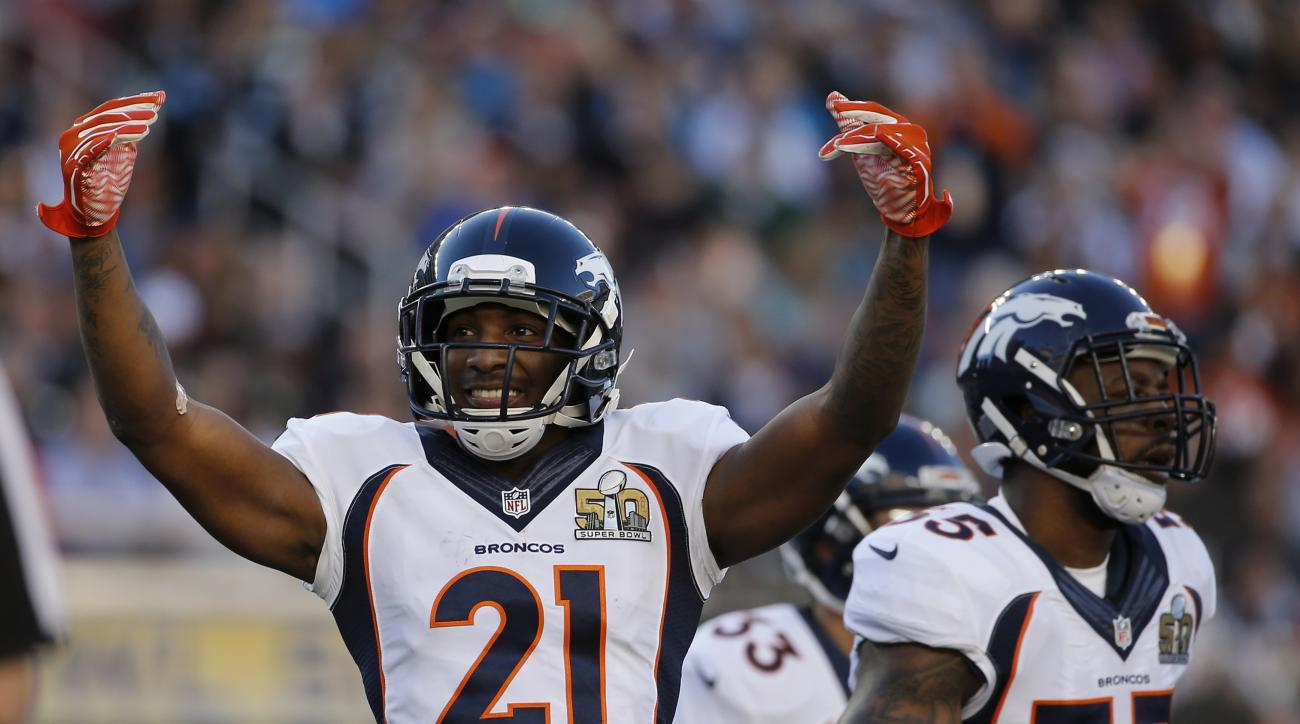 Denver Broncos Aqib Talib (21) cheers during the first half of the NFL Super Bowl 50 football game against the Carolina Panthers, Sunday, Feb. 7, 2016, in Santa Clara, Calif. (AP Photo/Matt Slocum)