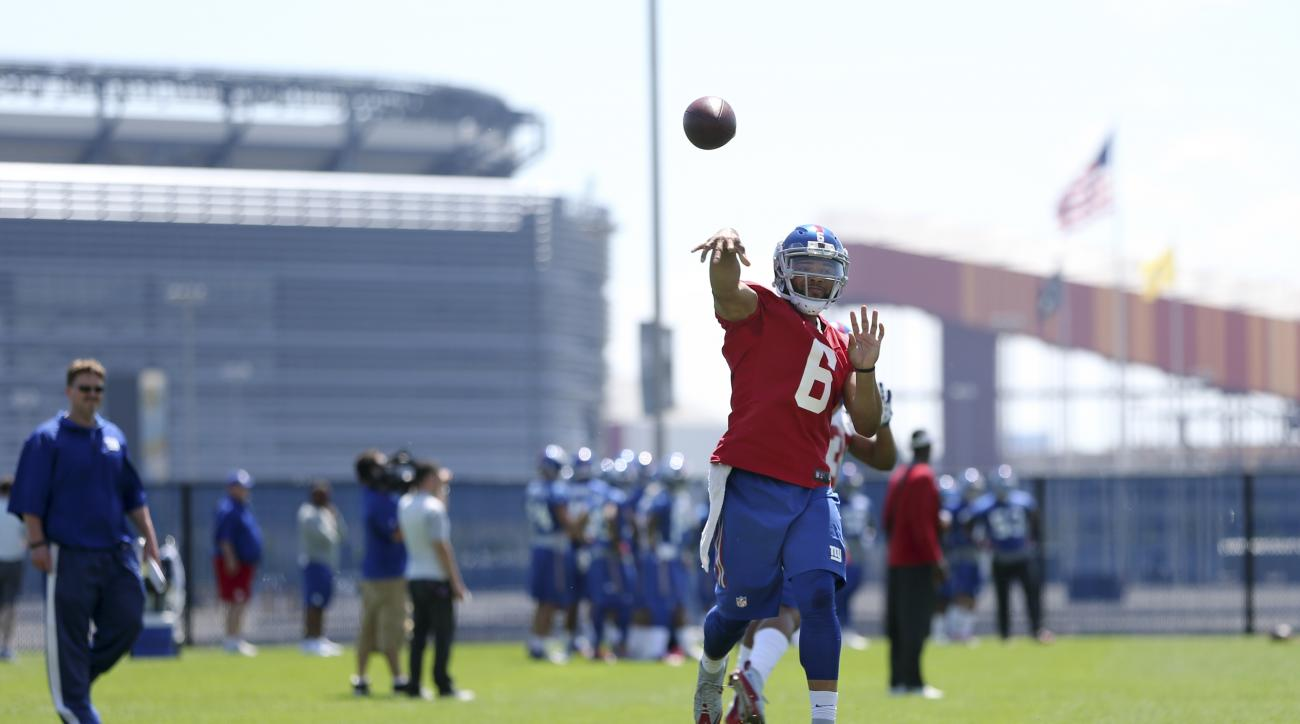 New York Giants quarterback BJ Daniels (6) throws a pass during practice at the New York Giants training facility Monday, June 6, 2016, in East Rutherford, N.J. (AP Photo/Mel Evans)