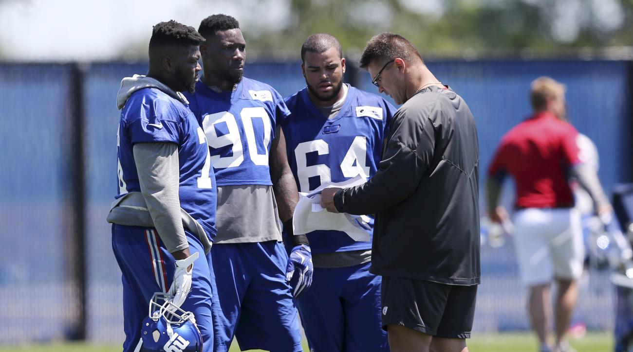 New York Giants defensive end Jason Pierre-Paul (90), and defensive tackles Melvin Lewis (76),and Greg Millhouse (64) listen to assistant defensive line coach Jeff Zgonina during practice at the New York Giants training facility Monday, June 6, 2016, in E