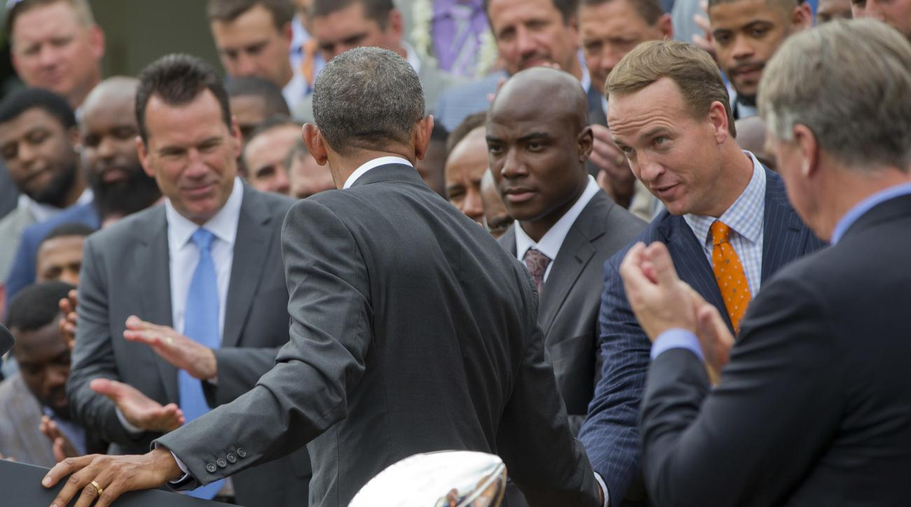President Barack Obama shakes hands with quarterback Peyton Manning, right, as he welcomes the Denver Broncos Super Bowl Champions during a ceremony in the Rose Garden of the White House in Washington, Monday, June 6, 2016, to honor the team and their Sup
