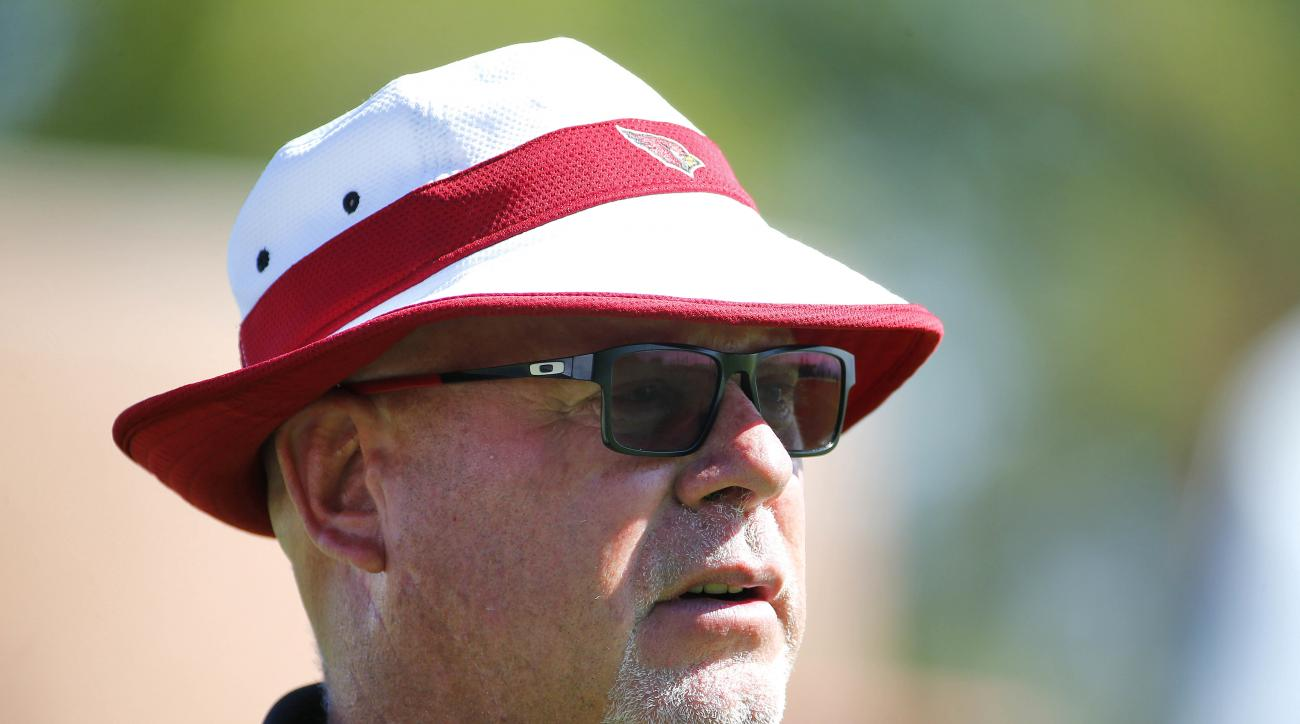 Arizona Cardinals head coach Bruce Arians runs drills during an NFL football minicamp, Tuesday, June 7, 2016, in Tempe, Ariz. (AP Photo/Matt York)