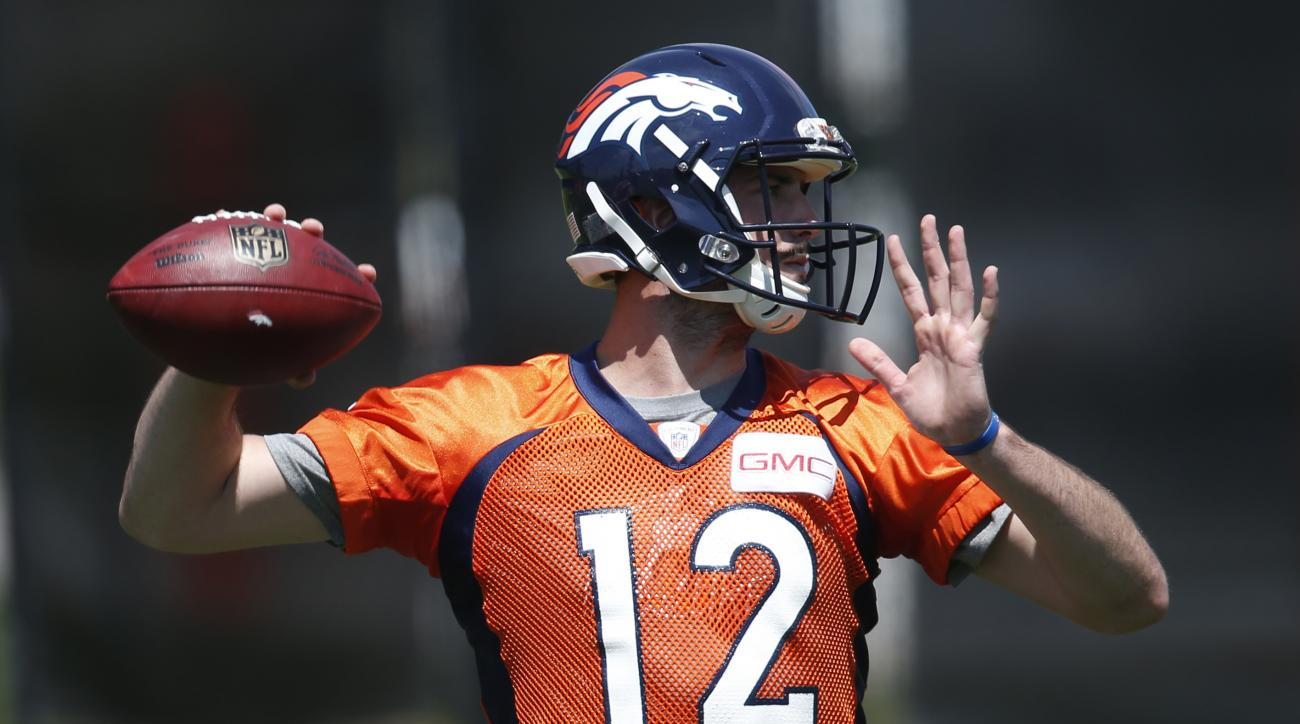 Denver Broncos rookie quarterback Paxton Lynch throws a pass during an NFL football practice at the team's headquarters Tuesday, June 7, 2016, in Englewood, Colo. (AP Photo/David Zalubowski)
