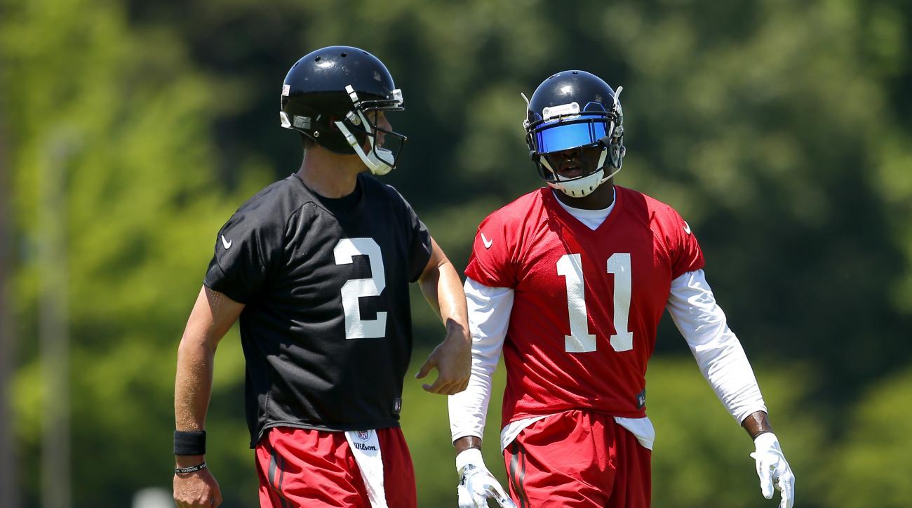 Atlanta Falcons quarterback Matt Ryan (2) speaks with wide receiver Julio Jones (11) during an NFL football practice in Flowery Branch, Ga. Tuesday, June 7, 2016. (AP Photo/Todd Kirkland)