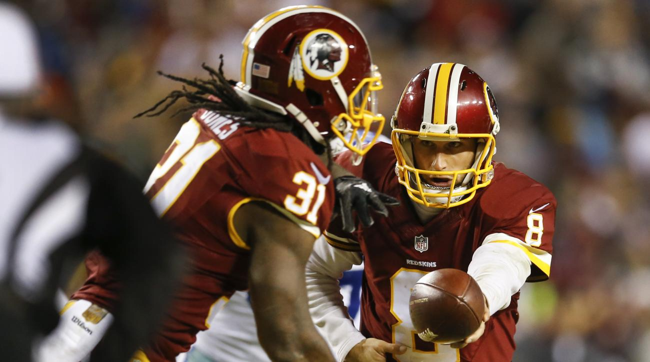 In this photo taken Dec. 7, 2015, Washington Redskins running back Matt Jones (31)  gets a hand off from quarterback Kirk Cousins (8) during the first half of an NFL football game against the Dallas Cowboys in Landover, Md. Jones finds it strange not to s