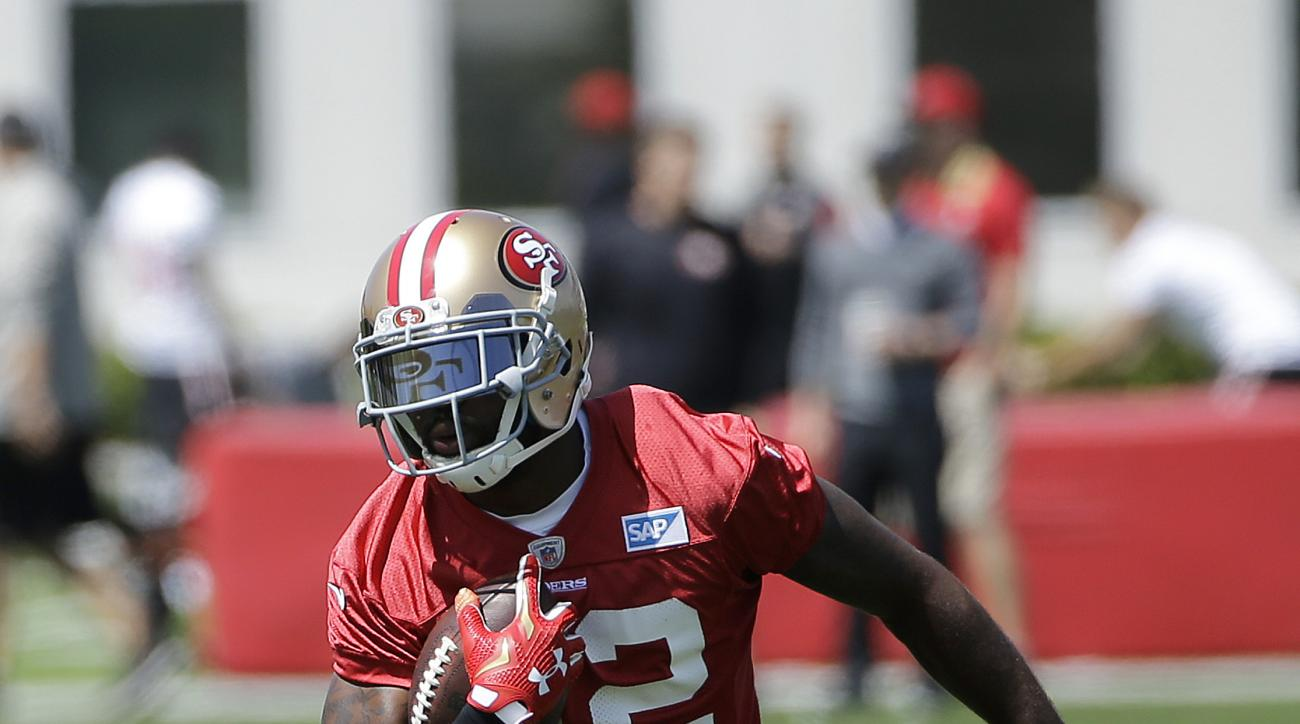 San Francisco 49ers wide receiver Torrey Smith (82) runs during an NFL football practice in Santa Clara, Calif., Wednesday, June 8, 2016. (AP Photo/Jeff Chiu)