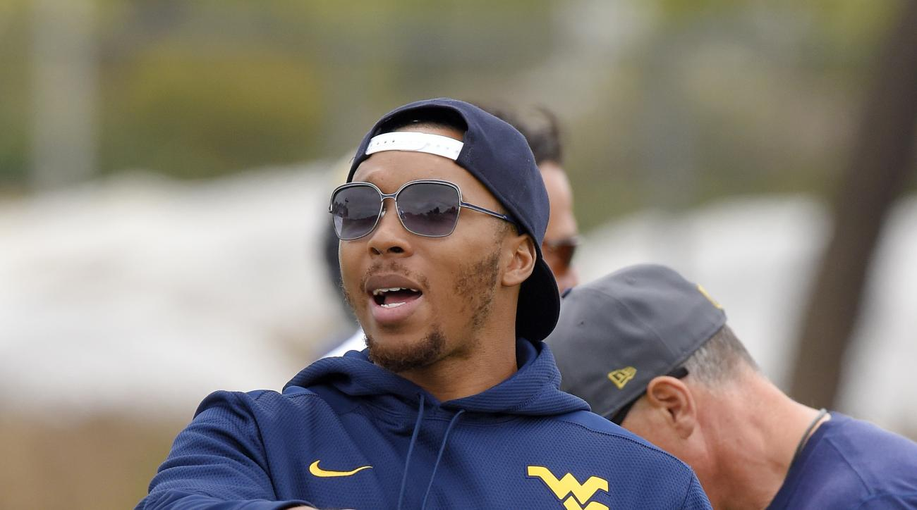 FILE - In this Wednesday, June 1, 2016, file photo, Los Angeles Rams wide receiver Stedman Bailey gestures during NFL football practice in Oxnard, Calif. The Rams waived Bailey this week, but they intend to keep the receiver around the team while he recov