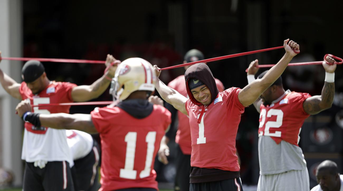 San Francisco 49ers players stretch during an NFL football practice Thursday, June 9, 2016, in Santa Clara, Calif. (AP Photo/Marcio Jose Sanchez)