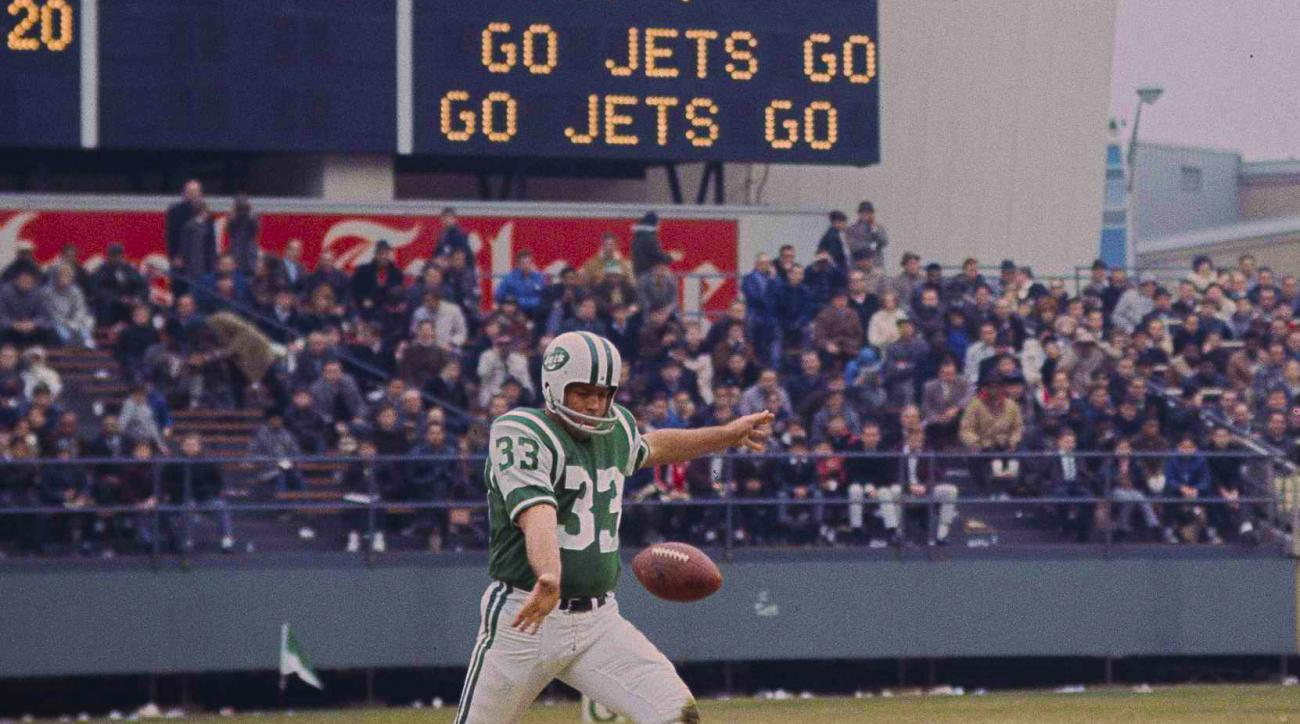 FILE - In this Nov. 21, 1965, file photo, New York Jets' Curley Johnson (33) is pictured during action against the Houston Oilers in New York. Curley Johnson, who punted for the New York Jets in their Super Bowl victory in 1969, has died. He was 80.The te