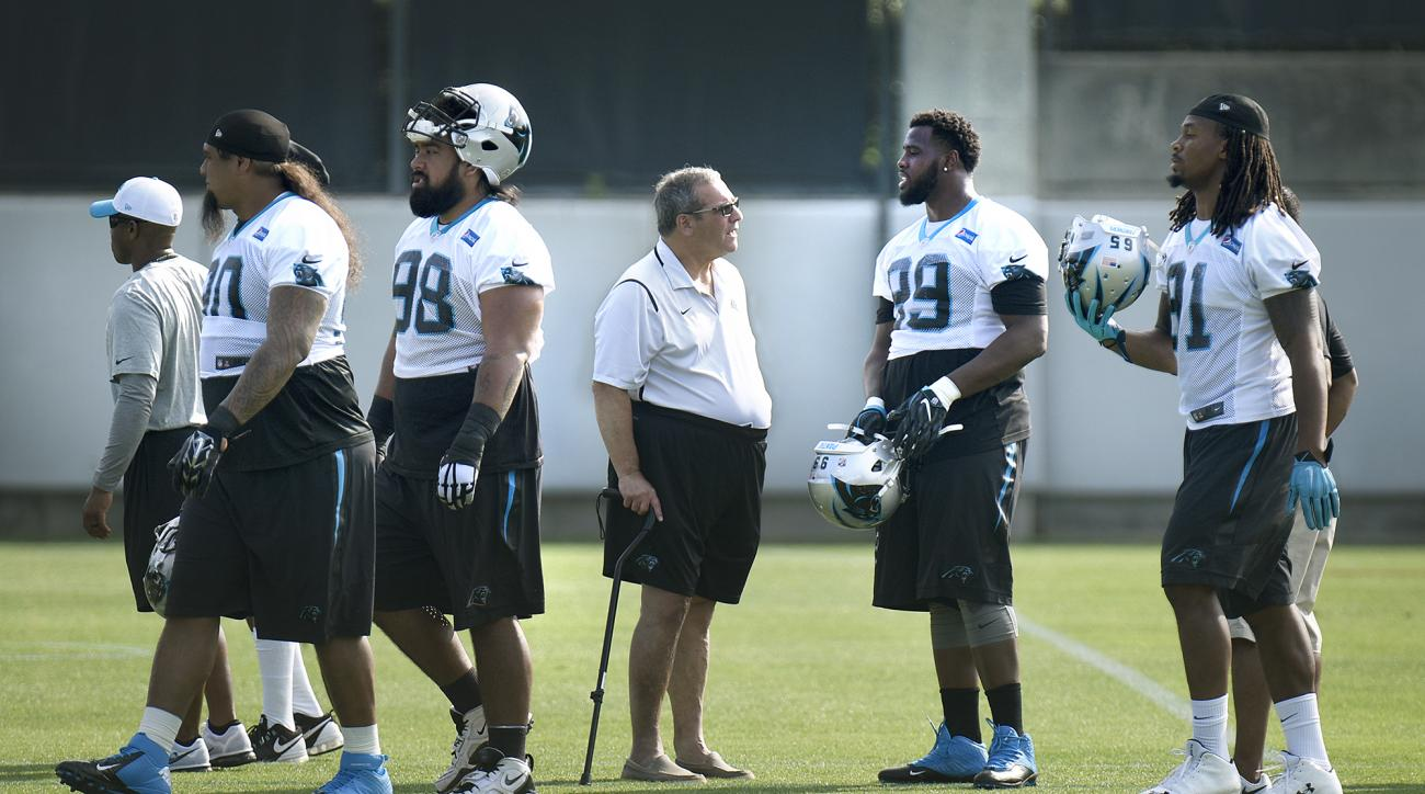 Carolina Panthers general manager Dave Gettleman talks with Kawann Short (99) during the Panthers NFL football minicamp on Tuesday, June 14, 2016, in Charlotte, N.C. (John D. Simmons/The Charlotte Observer via AP) MANDATORY CREDIT