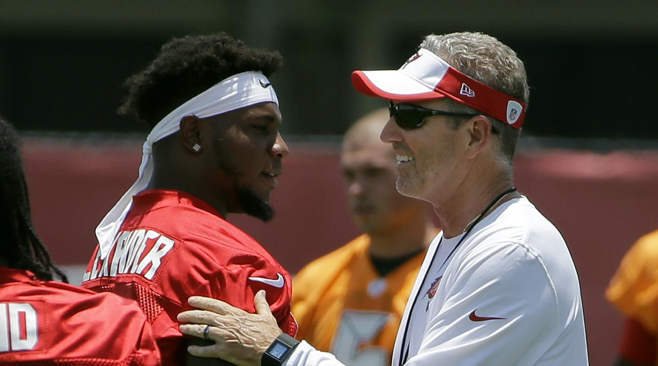 Tampa Bay Buccaneers head coach Dirk Koetter, right, greets middle linebacker Kwon Alexander (58) before drills at an NFL football minicamp Tuesday, June 14, 2016, in Tampa, Fla. (AP Photo/Chris O'Meara)