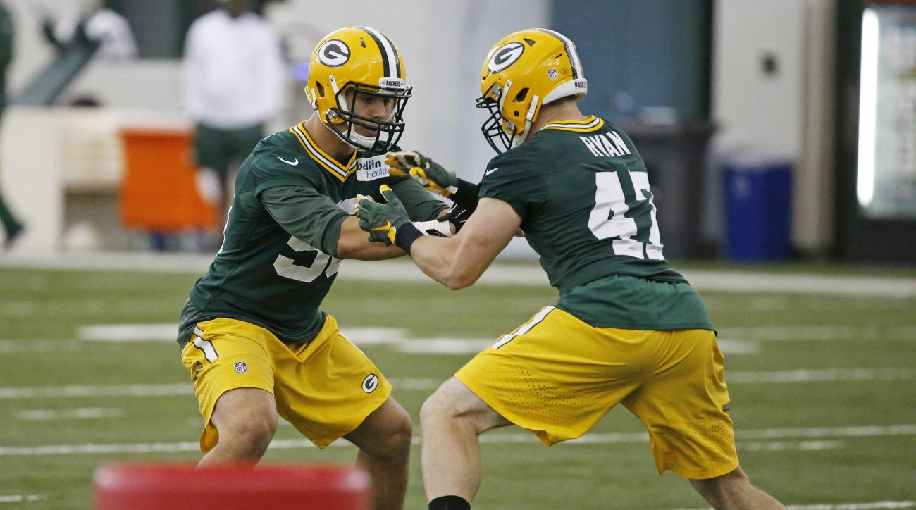 FILE - In this June 6, 2016, file photo, Green Bay Packers linebackers Blake Martinez (50) and linebackers Jake Ryan (47) participate in drills during NFL football practice in Green Bay, Wis. Martinez has been making a case to be in the mix when the insid